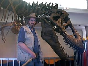 """Paleontologist John (""""Jack"""") R. Horner with a T. Rex skeleton."""