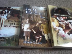 The Saga of Lucy McGregor and two more books by Johnnie G. Love: For My Brother's Sake, and Where the Magnolias Bloom.